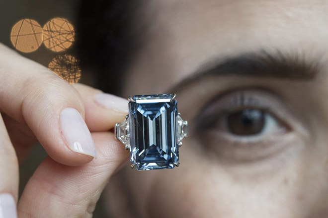 epa05302018 A Christie s employee holds an Oppenheimer Blue diamond of  14.62 carats bf06894c0e9