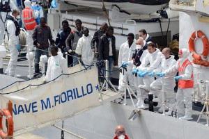 epa04718920 Some 84 immigrants rescued in the Strait of Sicily disembark from Italian Coast Guard 'Fiorillo' ship upon their arrival at the port of Catania, Sicily island, Italy, 24 April 2015. EU leaders agreed on 24 April in Brussels to triple funding for the bloc's sea patrols and advanced plans for possible military action against smuggling networks, reacting to a deadly migrant shipwreck.  EPA/MARCO COSTANTINO