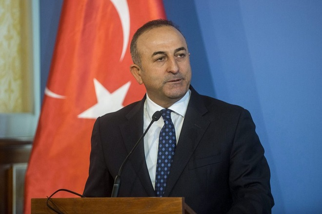 epa05151130 Turkish Foreign Minister Mevlut Cavusoglu speaks during his press conference with his Hungarian counterpart Peter Szijjarto in the Foreign Ministry building in Budapest, Hungary, 09 February 2016.  EPA/JANOS MARJAI HUNGARY OUT