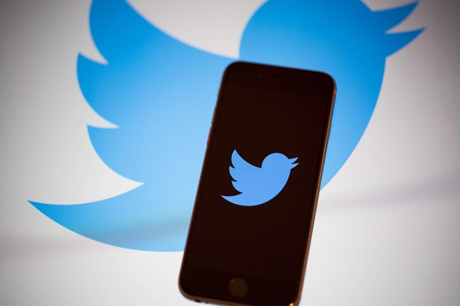 The Twitter Inc. logo is displayed on the screen of an Apple Inc. iPhone 6s in this arranged photograph taken in New York, U.S., on Tuesday, Feb. 9, 2016. Twitter Inc. is changing its timeline to display popular tweets first, instead of the latest posts, a long-anticipated step thats likely to anger its most passionate users. Twitter is scheduled to report quarterly earnings results following the close of U.S. financial markets on February 10. Photographer: Michael Nagle/Bloomberg via Getty Images