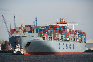 Hong Kong flagged COSCO Pacific departing Hamburg Harbour for Antwerp.