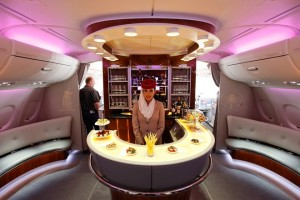 A picture shows the bar in the first class section on board an Airbus A380 passenger plane of Emirates Airline at the ILA International Air Show in Schoenefeld outside Berlin, June 8, 2010. Dubai's Emirates, the Arab world's largest airline, has placed an $11 billion order for 32 A380 jets from EADS's Airbus unit, the biggest ever for the company's superjumbo passenger plane.REUTERS/Thomas Peter  (GERMANY - Tags: TRANSPORT BUSINESS SOCIETY) - RTR2EWEH