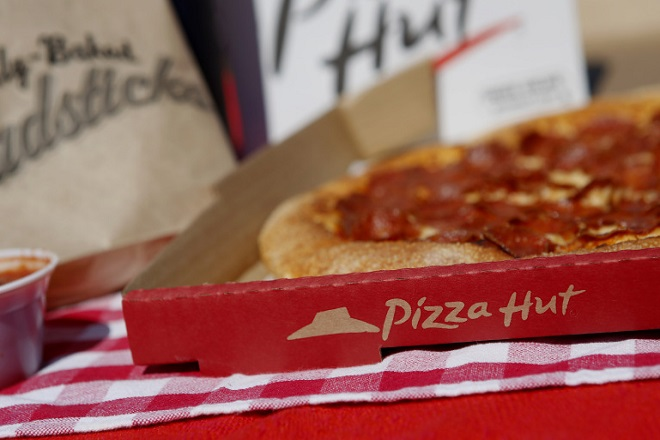 Breadsticks and a pepperoni pizza from a Pizza Hut restaurant, a unit of Yum! Brands Inc., are arranged for a photograph in Torrance, California, U.S., on Monday, Oct. 7, 2013. Yum! Brands Inc. is scheduled to release earnings data on Oct. 8. Photographer: Patrick T. Fallon/Bloomberg via Getty Images
