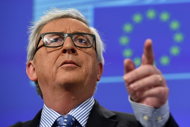 European Commission President Jean-Claude Juncker addresses a press conference at the European Commission in Brussels on January 15, 2016.  / AFP / EMMANUEL DUNAND        (Photo credit should read EMMANUEL DUNAND/AFP/Getty Images)