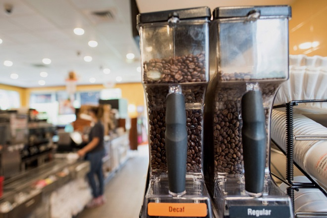 Coffee Beans sit in a container at a Dunkin' Donuts Inc. location in Ramsey, New Jersey, U.S., on Thursday, May 5, 2016. Dunkin' Brands Group Inc., a leading franchiser in the quick service restaurants (QSR) sector, operates in almost 60 countries around the world with more than 11,300 Dunkin' Donuts restaurants and 7,500 Baskin-Robbins locations. Photographer: Ron Antonelli/Bloomberg via Getty Images