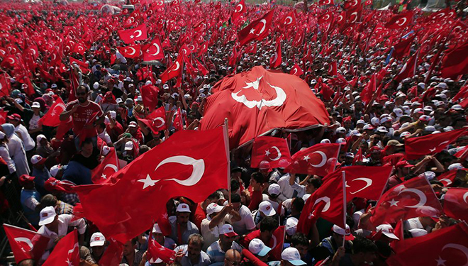 epa05461251 People wave Turkish flags during a rally to protest the failed coup attempt at 15th July 2016 and mourn the 240 killed people including civilians, policemen, and soldiers, 07 August 2016, Istanbul. Thousands of people attended a massive  democracy rally in Istanbul to protest the 15 th coup attempt.  The president, prime minister, main opposition head and the leader of the country's foremost nationalist party join the rally.  EPA/SEDAT SUNA