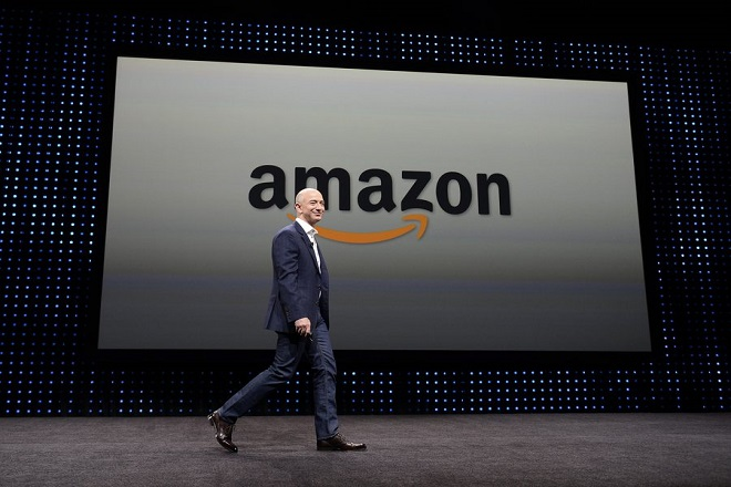 epa03814152 (FILE) A file photograph showing Amazon CEO Jeff Bezos walking on stage at a press conference where he introduced new Kindle products such as the Kindle Paperwhite Wi-Fi + 3G, the Kindle Fire HD and new programs and innovations for the wireless tablets at Santa Monica Airport in Santa Monica, California, USA, 06 September 2012.  Media reports on 05 August 2013 that The Washington Post Company has agreed to sell its flagship newspaper to Bezos for 250 million US dollars (188.5 million euros) ending the Graham family's long-time ownership of the paper.  EPA/MICHAEL NELSON *** Local Caption *** 50510966