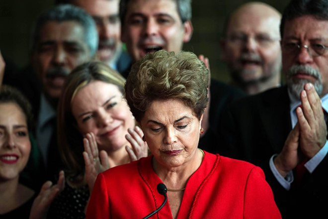 epa05517422 Former Brazilian President, Dilma Rousseff (C) delivers a statement to the press at Alborada Palace, Brasilia, Brazil, 31 August 2016. Brazil's Senate on 31 August 2016 voted to impeach Dilma Rousseff after finding her guilty of manipulating the state budget. Interim President Michel Temer will complete her mandate, which ends on 01 January 2019.  EPA/FERNANDO BIZERRA JR