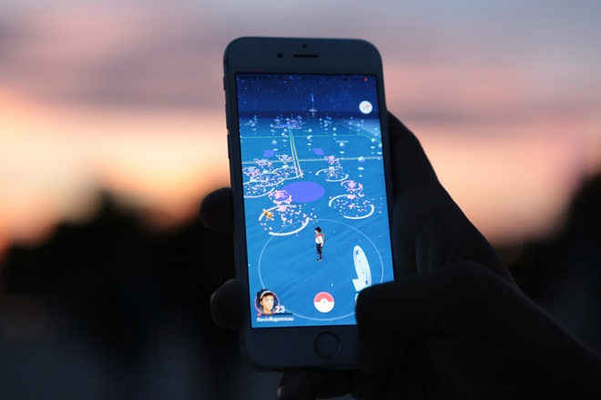 PARIS, FRANCE - AUGUST 17: A man plays Nintendo Co.'s Pokemon Go augmented-reality game on August 17, 2016 in Paris, France. His smartphone screen displays his avatar watching a Pokemon near a Pokestop.  (Photo by Edward Berthelot/Getty Images)