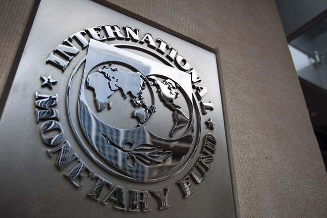 epa04824587 (FILE) A file photo dated 18 May 2011 showing the logo of the International Monetary Fund (IMF) at the entrance of the Headquarters of the IMF, also known as building HQ2, in Washington, DC, USA. Greece will not make the 1.6-billion-euro (1.8-billion-dollar) repayment due 30 June 2015 to the International Monetary Fund unless it strikes a deal in the coming hours with its creditors, Prime Minister Alexis Tsipras said in Athens as the deadline loomed. He implied that his left-wing government would resign if Greeks vote 'yes' in a planned 05 July referendum on a renegotiated bailout. The Greek vote is widely seen as deciding whether the near-bankrupt country stays in the eurozone. No country has left the currency bloc since its founding in 1999.  EPA/JIM LO SCALZO