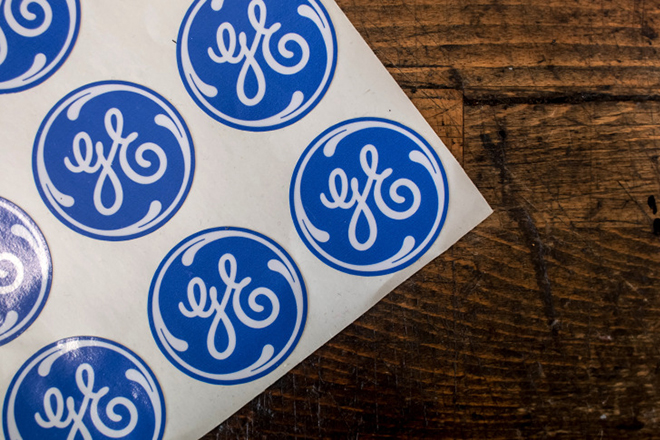 Stickers bearing the General Electric Co. (GE) logo sit in a workshop at the GE Aviation Czech s.r.o. plant in Prague, Czech Republic, on Tuesday, May 31, 2016. General Electric Co. agreed to participate in as much as $3 billion of investments across industries in Saudi Arabia as the desert kingdom seeks to diversify its economy away from oil. Photographer: Martin Divisek/Bloomberg via Getty Images