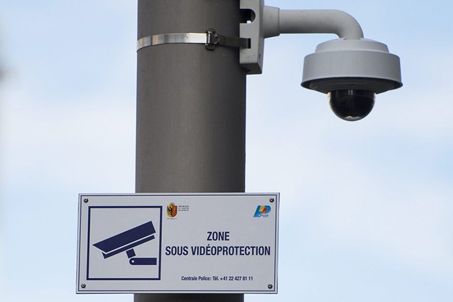 epa05555150 (FILE) A file photograph showing a surveillance camera and a sign indicating the surveillance zone are photographed in the neighborhood of Paquis close to the central train station in Geneva, Switzerland, 14 October 2014. On 25 September 2016, the Swiss electorate will vote on the Intelligence Service Act. The Federal Intelligence Service (FIS) the government states helps to make Switzerland a safer and more secure place. Its task is to identify threats, such as those from terrorist organizations, at an early stage and to prevent related attacks on Switzerland. The intelligence that the FIS gathers allows political decision-makers to take suitable countermeasures swiftly when our security is under threat.  EPA/JEAN-CHRISTOPHE BOTT