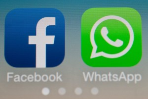 epa04090101 The two logos of Facebook (L) and Whatsapp pictured on the screen of a smartphone in Sieversdorf, Germany, 19 February 2014. Facebook announced on 19 February that it acquired the globally popular messaging system WhatsApp for 19 billion US dollar. Facebook paid 12 billion US dollar in shares and four billion US dollar in cash. The deal includes an additional three billion US dollar in Facebook stock for WhatsApp founders and employees. The deal should close later in 2014 and is still subject to regulatory approval, according to Facebook founder and Chief Executive Officer Mark Zuckerberg, who said in the conference call that he did not expect any issues. Additionally, WhatsApp co-founder and Chief Executive Officer Jan Koum will join the Facebook Board of Directors.  EPA/PATRICK PLEUL