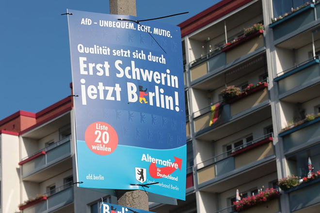 epa05547763 An election poster of Alternative for Germany (AfD) party hangs from a lamppost in the Marzahn-Hellersdorf area of Berlin, Germany, 19 September 2016. Extreme right-wing AfD entered Berlin's state parliament for the first time. The poster reads 'Quality wins through. First Schwerin, now Berlin!'  EPA/JOERG CARSTENSEN