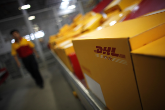 An employee is seen next to his workstation during a operational test of the new DHL North Asia Hub in Shanghai July 12, 2012. REUTERS/Carlos Barria (CHINA - Tags: BUSINESS TRANSPORT) - RTR34UOS