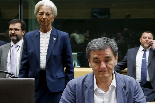 """Greek Finance Minister Euclid Tsakalotos and International Monetary Fund (IMF) Managing Director Christine Lagarde (back C) attend an euro zone finance ministers meeting in Brussels, Belgium, July 12, 2015. Euro zone leaders will fight to the finish to keep near-bankrupt Greece in the euro zone on Sunday after the European Union's chairman cancelled a planned summit of all 28 EU leaders that would have been needed in case of a """"Grexit"""".  REUTERS/Francois Lenoir      TPX IMAGES OF THE DAY"""