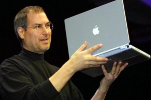 SAN FRANCISCO, UNITED STATES:  Steve Jobs, CEO of Apple Computer unveils a new titanium G4 Powerbook with a 15.2 inch screen during his keynote address at the MacWorld Expo in San Francisco,CA, 09 January 2001. Jobs also announced new configurations of the G4 desktop Macs as well as new audio and DVD software. AFP PHOTO/John G. MABANGLO (Photo credit should read JOHN G. MABANGLO/AFP/Getty Images)