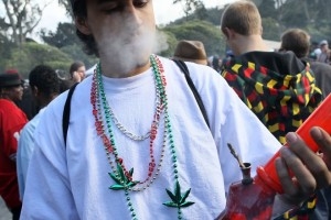 """SAN FRANCISCO - APRIL 20:  A marijuana user smokes from a bong during a 420 Day celebration on """"Hippie Hill"""" in Golden Gate Park April 20, 2010 in San Francisco, California. April 20th has become a de facto holiday for marijuana advocates, with large gatherings and 'smoke outs' in many parts of the United States. Voters in California will consider a measure on the November general election ballot that could make the State the first in the nation to legalize the growing of a limited amount of marijuana for private use.  (Photo by Justin Sullivan/Getty Images)"""