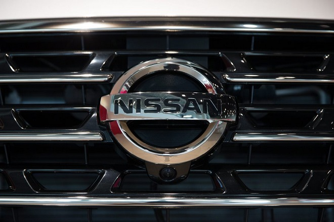 epa05301038 The logo of Nissan is seen on the front grill of a vehicle on display at the company's global headquarters showroom in Yokohama, south of Tokyo, Japan, 12 May 2016. Nissan Motor Company posted a operating profit more than 34 percent to 793.3 billion yen (6.6 billion US dollars).  EPA/CHRISTOPHER JUE