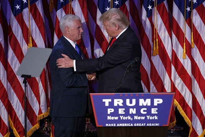 epa05623796 US President-elect Donald Trump (R) and Vice President-elect Mike Pence (L) skaes hands as he delivers a speech on stage at his 2016 US presidential Election Night event as votes continue to be counted at the New York Hilton Midtown in New York, New York, USA, 08 November 2016. US businessman Republican Donald Trump has won the US presidential election. Americans voted on Election Day to choose the 45th President of the United States of America to serve from 2017 through 2020.  EPA/SHAWN THEW