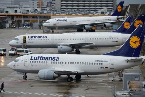 FRANKFURT AM MAIN, GERMANY - OCTOBER 21:  A man walkes in front of Lufthansa airplanes at the Frankfurt Airport on October 21, 2014 in Frankfurt am Main, Germany. Vereinigung Cockpit, the labor union that represents the pilots, launched the two-day strike yesterday that has been expanded from short and medium-distance flights on the first day to long haul flights today, affecting over 100,000 passengers. This is the seventh strike by Lufthansa and Germanwings (a Lufthansa subsidiary) pilots this year as the union attempts to maintain the Lufthansa pilots' early retirement guarantee, a benefit that Lufthansa is trying to cut.  (Photo by Thomas Lohnes/Getty Images)