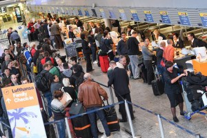 epa05644929 People gather around Lufthansa counters  inside the airport in Frankfurt am Main,Germany, 24 November 2016. Numerous planes have been cancelled in Munich on the second day of the pilots' strike at Lufthansa.  EPA/ARNE DEDERT