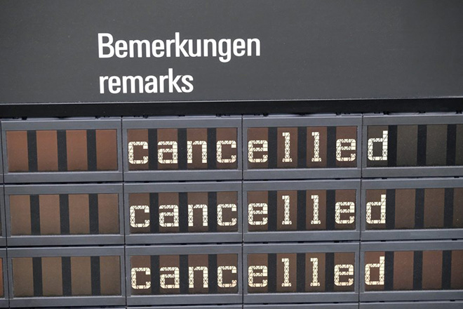 epa05646772 A flight information display reading 'cancelled' at the Leipzig-Halle airport in Schkeuditz, Germany, 25 November 2016. Due to the ongoing pilot strike, Lufthansa cancelled 137 flights for 26 November 2016, affecting roughly 30,000 passengers.  EPA/SEBASTIAN WILLNOW