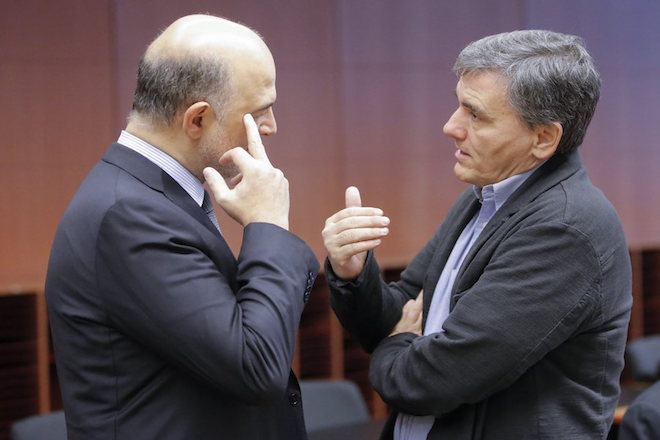 epa05660649 European commissioner in charge of Economic and Financial Affairs Pierre Moscovici (L) and Greek Finance Minister Euclidis Tsakalotos (R) during Eurogroup finance ministers meeting in Brussels, Belgium, 05 December 2016. Eurogroup discuss member states' draft budgetary plans for 2017 and will be briefed by the institutions on the state of play of the Greek second review of the economic adjustment programme.  EPA/OLIVIER HOSLET