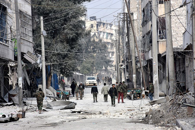 epa05673959 A handout photograph released by the official Syrian Arab News Agency (SANA) on 13 December 2016 showing Syrian soldiers patrolling a neighborhood in Aleppo after recapturing it from rebels, in Aleppo, Syria, 12 December 2016. Media reports state the Syrian army on 12 December claimed it had recaptured 98 percent of former rebel territory in eastern Aleppo. The huge regime gains come as part of the military offensive launched by forces loyal to President Bashar Assad on 15 November. Since then, over 1,000 people have been killed in the northern Syrian city.  EPA/SANA HANDOUT  HANDOUT EDITORIAL USE ONLY/NO SALES
