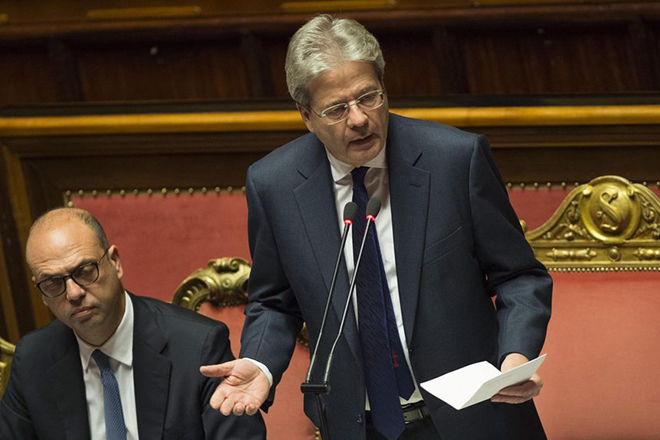 epa05675236 Italian Prime Minister Paolo Gentiloni (R) is flanked by Italian Foreign Minister Angelino Alfano (L) as he delivers a speech at the Senate prior to a vote of confidence on Gentiloni's government, in Rome, Italy, 14 December 2016. The Upper House of the Italian Parliament is to vote on Gentiloni's government on 14 December, one day after the lower house, the Chamber of Deputies, had confirmed Prime Minister Gentiloni in their voting by 368 (Yes) votes to 105 votes against him.  EPA/GIORGIO ONORATI