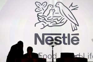 epa05247896 Nestle's directors speak in front of the Nestle's logo during the general meeting of Nestle Group in Lausanne, Switzerland, 07 April 2016. The world's biggest food and beverage company holds its 149th annual general meeting.  EPA/LAURENT GILLIERON