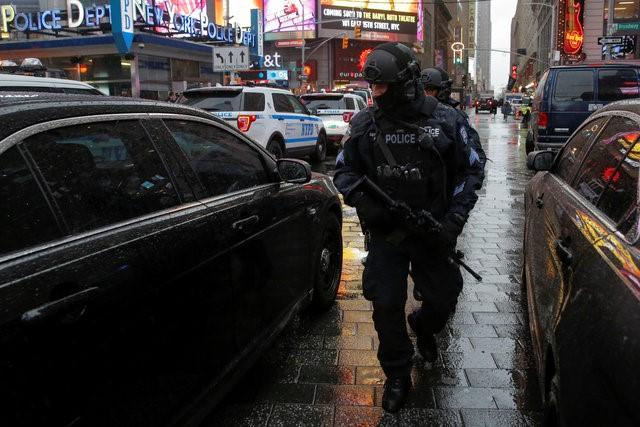 Members of the New York Police Department's Counterterrorism Bureau patrol Times Square in the lead up to New Year's celebrations in Manhattan, New York City, U.S. December 29, 2016. REUTERS/Andrew Kelly