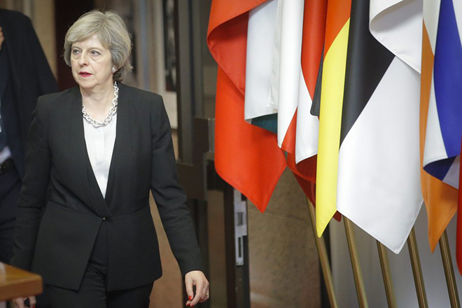 epa05677536 Britain's Prime Minister Theresa May leaves at the end of an European Summit in Brussels, Belgium, 15 December 2016. EU leaders meet for a one-day summit which will mainly focus on the implementation of the EU-Turkey agreement on migration and the EU Internal Security Strategy. 27 leaders are scheduled to later meet informally for a dinner to discuss the Brexit process.  EPA/OLIVIER HOSLET