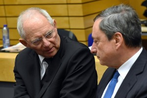 German Finance Minister Wolfgang Schauble (L) speaks with European Central Bank President Mario Draghi during an emergency Eurogroup finance ministers meeting at the European Council in Brussels on February 11, 2015. Proposals by the new government in Athens to renegotiate the terms of its massive international bailout are scheduled to be discussed by eurozone finance ministers in Brussels on February 11 and 12. AFP PHOTO / EMMANUEL DUNAND        (Photo credit should read EMMANUEL DUNAND/AFP/Getty Images)