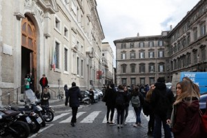 People stand outside an evacuated school after three earthquakes hit central Italy in the space of an hour, shaking the same region that suffered a series of deadly quakes last year, in Rome, Wednesday, Jan. 18, 2017. There were no immediate reports of casualties but tremors were felt as far away as Rome, where the subway was closed as a precaution and parents were asked to pick up their children early from schools.  (AP Photo/Gregorio Borgia)