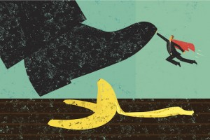 A miniature, super businessman saves someone from slipping on a banana peel. The shoe, man, and banana peel are on a separately labeled layer from the background.