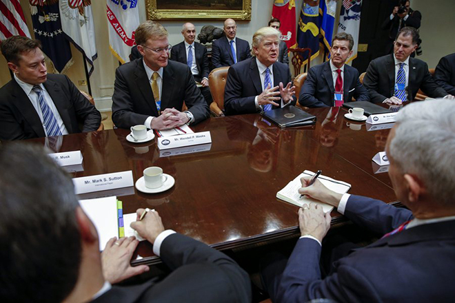 epa05744611 US President Donald J. Trump (C), with the Tesla and Spacex CEO Elon Musk (L), CEO of Corning Wendell Weeks (2-L), CEO of Johnson & Johnson Alex Gorsky (2-R) and CEO of Dell Technologies Michael Dell (R), delivers remarks in a meeting with business leaders in the Roosevelt Room of the White House in Washington, DC, USA, 23 January 2017. Others are not identified. President Trump was set for a day of meetings with Business leaders, Union leaders, Congressional leaders and meeting with Speaker of the House, Paul Ryan later this afternoon.  EPA/SHAWN THEW