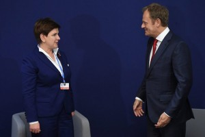 epa05049498 Polish Prime Minister Beata Szydlo (L) and European Council President Donald Tusk (R) at a meeting during COP21 Climate Change Conference in Paris, France, 30 November 2015. The 21st Conference of the Parties (COP21) is held in Paris from 30 November to 11 December aimed at reaching an international agreement to limit greenhouse gas emissions and curtail climate change.  EPA/RADEK PIETRUSZKA POLAND OUT