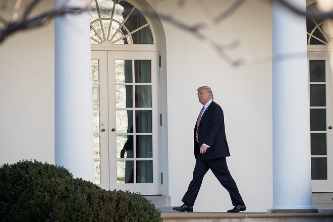 WASHINGTON, DC - JANUARY 26: Upon returning from Philadelphia, U.S. President Donald Trump walks along the West Wing Colonnade on his way to the Oval Office at the White House, January 26, 2017 in Washington, DC. President Trump traveled to Philadelphia for the Joint GOP Issues Conference. (Photo by Drew Angerer/Getty Images)