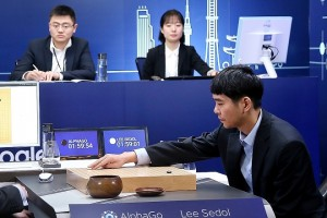 SEOUL, SOUTH KOREA - MARCH 13:  In this handout image provided by Google, South Korean professional Go player Lee Se-Dol (R) puts his first stone against Google's artificial intelligence program, AlphaGo, during the fourth Google DeepMind Challenge Match on March 13, 2016 in Seoul, South Korea. Lee Se-dol played a five-game match against a computer program developed by a Google, AlphaGo.  (Photo by Google via Getty Images)