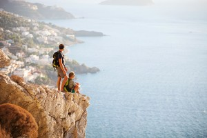 Young couple resting on edge of rock