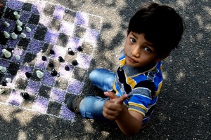 epa05240432 A boy plays chess while attending the 'Autistic Children Fair' a street fest to contribute the cause of raising awareness of Autism in children, organised by I support foundation an non-governmental organisation in Bangalore, India, 02 April 2016. During the event over children play games with their families and volunteers to celebrate World Autism Awareness Day. The UN General Assembly designated 02 April each year as the World Autism Awareness Day to highlight the need to help improve the quality of life of children and adults, who are affected by autism.  EPA/JAGADEESH NV
