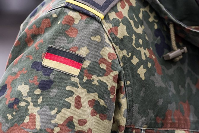 epa05763069 A german flag is seen onto the uniform of a German Bundeswehr Soldier of the 'battalion of armored infantryman' called 'Panzergrenadierbataillon 122' during vehicles wait to be loaded onto a train in Grafenwoehr, Germany, 31 January 2017, before being deployed as part of a NATO force in Lithuania. NATO state that it is enhancing its forward presence in the eastern part of the Alliance, with four multinational battalions in Estonia, Latvia, Lithuania and Poland, on a rotational basis. These battalions, led by the United Kingdom, Canada, Germany and the United States respectively, will be robust, multinational, combat-ready forces demonstrating the strength of the transatlantic bond, and making clear that an attack on one Ally would be considered an attack on the whole Alliance.  EPA/LUKAS BARTH