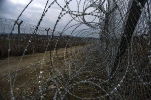 epa05788257 A view of the fence on the border between Macedonia and Greece, near the southern city of Gevgelija, The Former Yugoslav Republic of Macedonia, on 12 February 2017. About 60 migrants and refugees are stuck in the camp since the last 11 mounts. In a recent decision of ministers of 15 European countries in Vienna, Austria, they agreed to prepare new plans and measures that are expected to be presented in April and May to keep the so-called 'Balkan route' - the migration route from Greece to the EU, leading through Macedonia - closed.  EPA/GEORGI LICOVSKI