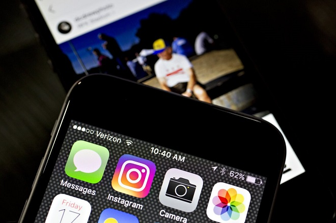 Facebook Inc.'s Instagram logo is displayed on an Apple Inc. iPhone in this arranged photograph taken in Washington, D.C., U.S., on Friday, June 17, 2016. In a bid to give its users an incentive to create more content for the photo and video-sharing site, Facebook's Instagram is considering sharing revenue generated from news, sports, celebrities and other content said Carolyn Everson, vice president for global marketing solutions at Facebook. Photographer: Andrew Harrer/Bloomberg via Getty Images
