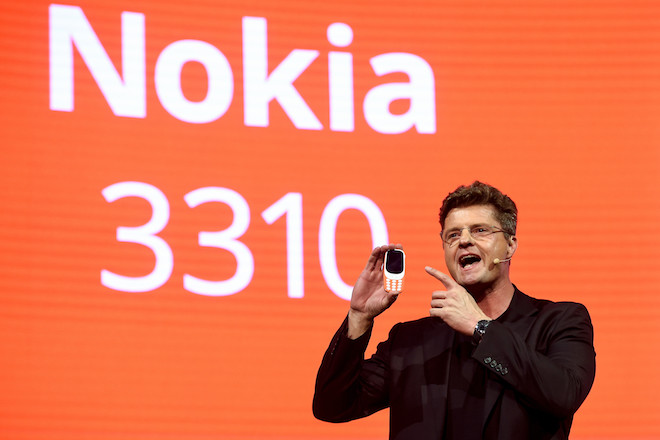 "HMD global CEO Arto Nummela presents his company's new phone ""Nokia 3310"" during a press conference on February 26, 2017 on the eve of the start of the Mobile World Congress. Phone makers will seek to seduce new buyers with even smarter Internet-connected watches and other wireless gadgets as they wrestle for dominance at the world's biggest mobile fair starting tomorrow.  / AFP / Josep Lago        (Photo credit should read JOSEP LAGO/AFP/Getty Images)"