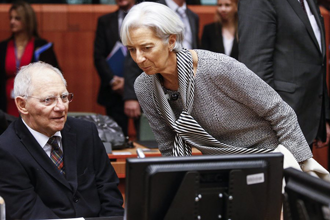 epa04629276 German Finance Minister Wolfgang Schaeuble (L) speaks with Managing Director of the International Monetary Fund (IMF) Christine Lagarde (R) during a special Eurogroup meeting of Finance Ministers on the situation in Greece, at the European Council headquarters, in Brussels, Belgium, 20 February 2015. The European Financial Stability Facility financial assistance to Greece expires at the end of February 2015. Greek's Finance minister had said ahead of the talks in Brussels that he hopes for an agreement over the country's bailout extension.  EPA/OLIVIER HOSLET