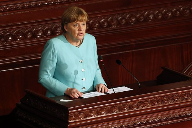 epa05827296 German Chancellor Angela Merkel delivers a speech at the Tunisian Constituent Assembly in Tunis, Tunisia, 03 March 2017. Merkel is on a one-day official visit to Tunisia.  EPA/MOHAMED MESSARA