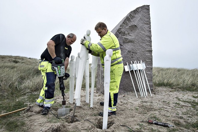 epa05325017 Craftsmen work on sculptures around the 'ship' HMS Defence with 903 death, in Thyboroen, Denmarkl, 23 May 2016. A memorial park to mark the world's largest naval battle that took place 31 May 1916 during World War will soon open in Denmark. The battle of Jutland had more than 240 warships involved from Britain and Germany. On one day 25 warships were destroyed and nearly 9,000 sailors perished. The memorial park is placed at Sea War Museum in Thyboroen, northern Jutland. Large granite stone with the name of the ships and number of deaths mark the vessels and sculptures around them symbolizing the 8647 dead sailors.  EPA/HENNING BAGGER