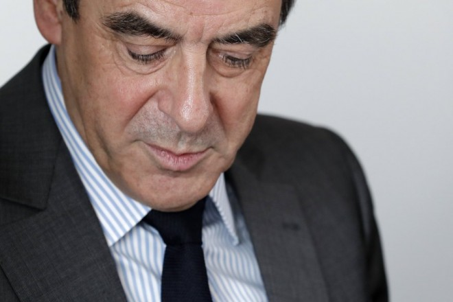 epa05848145 Francois Fillon, former French prime minister, member of the Republicains political party and 2017 presidential candidate of the French centre-right, reacts during a meeting at his campaign headquarters in Paris, France, 14 March 2017. Fillon's lawyer announced on 14 March 2017 that Francois Fillon was officially charged for several offences including misuse of public funds over the 'fake jobs' scandal.  EPA/CHRISTIAN HARTMANN / POOL MAXPPP OUT